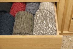 Open a well-organized wooden drawer. A well-organized closet drawer open. wooden storage system. Wardrobe order royalty free stock photos