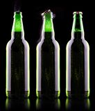 Open wet beer bottle. Isolated on black Royalty Free Stock Photography