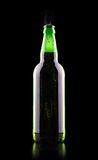 Open wet beer bottle. Isolated on black Royalty Free Stock Image