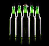 Open wet beer bottle. Isolated on black Royalty Free Stock Photos