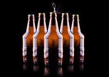 Open wet beer bottle. Isolated on black Stock Images
