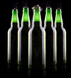 Open wet beer bottle. Isolated on black Royalty Free Stock Photo