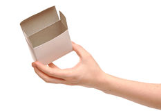 Open white box in woman hands Stock Images