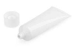 Open white cosmetic tube with cream Royalty Free Stock Photos