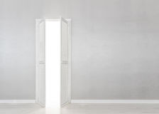 Open White Door on gray Wall Royalty Free Stock Photography
