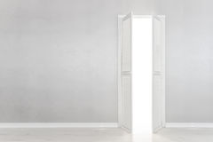 Open White Door on gray Wall Stock Photos