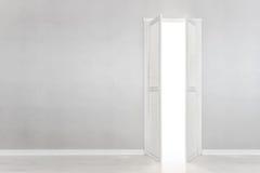 Open White Door on gray Wall stock photos