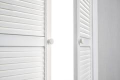 Open White Door on grey Wall Stock Image