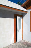 Open white door with orange trim Stock Photo