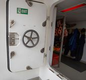 Open white door of a ship royalty free stock photography