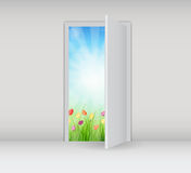 Open white door on a white wall with nature Stock Photos
