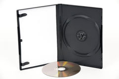 Open white DVD Case with a gold DVD Stock Images