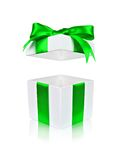 Open white gift box with green bow and floating lid Royalty Free Stock Photo