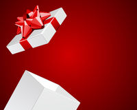 Open white gift  box with shiny red bow. Valentine's or wedding day backgroung Royalty Free Stock Images