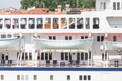Open White Lifeboats on Cruise Ship. Classic white lifeboats on a luxury cruise ship Stock Photo