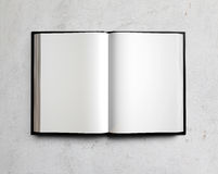 Open white textbook on concrete. 3d render. Open white textbook on concrete gray wall Royalty Free Stock Image