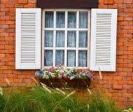 Open white window on red brick wall Stock Photos