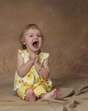 Open Wide. A young girl opens her mouth in glee and excitement royalty free stock image