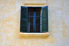 Open window. With green shutters in old house Royalty Free Stock Photo