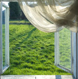 Open window. Photo of open window and view on the grass Stock Photography