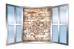 An open window against a solid brick wall. Stock Photos