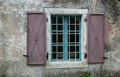 Open window with bars. And metal shutters Royalty Free Stock Images