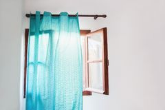Open window with blue curtains. On the white wall Royalty Free Stock Photos