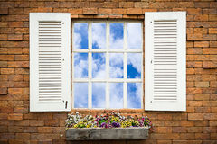 Open Window With Flower Basket On Brick  Wall Stock Images