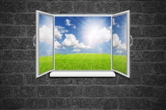 Open window from old room with landscape on Grey textured wall G Royalty Free Stock Image