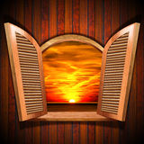 Open Window with View of the Sunset Stock Photography