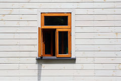 An open window on white wooden wall Stock Photography