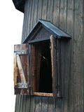 Open window of wooden house. This opened window belongs to an old round house of wood stock photo