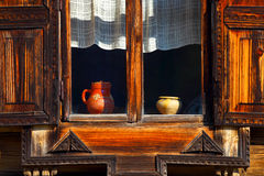 Open window with a wooden sun blind. Stock Photos