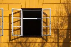 Open window and yellow bricks Stock Photo