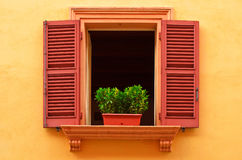Open window on the yellow wall Royalty Free Stock Photography