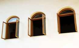 Open windows on white wall. Three open windows on a white wall Royalty Free Stock Photo