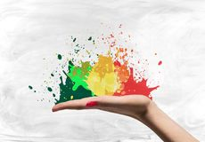 Open woman palm with splatters Stock Photos