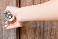 Open wood door. Girl is opening wooden door Stock Image