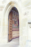 Open wood door revealing painted wall in Putna Monastery, Bucovi Royalty Free Stock Images
