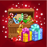 Open wood treasure chest with candy and cookies Royalty Free Stock Photos