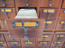 Open wooden boxes with index cards in library Royalty Free Stock Photography
