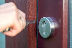 Open the wooden door with the key. Close up stock photography