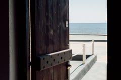 Open wooden door overlooking the sea on Santorini royalty free stock photography