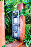 Open wooden door to the garden. Open wooden door to the tropical garden Royalty Free Stock Photography