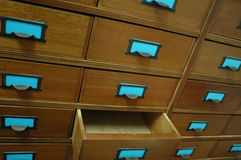 Open Wooden Drawer. Many wooden drawers, one is open and empty Royalty Free Stock Images
