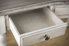 Open wooden drawer of vintage writting table Royalty Free Stock Image