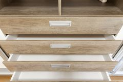 Open wooden drawers in the closet. Close up royalty free stock image