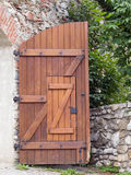 Open wooden gate. Half of open wooden gate with wicket stock photos