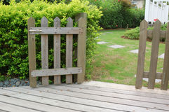 Open wooden gate and fence. In yard royalty free stock images