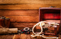Open wooden treasure chest with valuables Stock Image